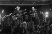 Los TexManiacs and special guest star Flaco Jimenez performed Friday eveing at the Bullock Museum as part of the Music Under the Star series. Max Baca of Los TexManiacs salutes Jiménez at the end of the show. Photo by Mark Matson ( 7/15/16)
