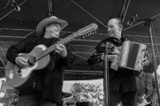 Los TexManiacs and special guest star Flaco Jimenez performed Friday eveing at the Bullock Museum as part of the Music Under the Star series. Max Baca (L) of Los TexManiacs and Flaco Jiménez share a moment on stage. Photo by Mark Matson ( 7/15/16)